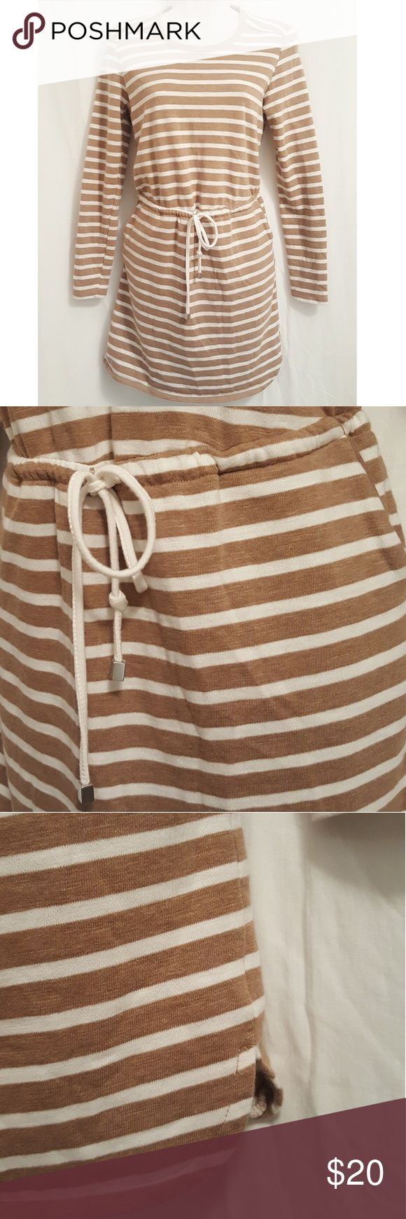 Merona stripe drawstring dress As shown,  vibrant,  mint condition,  last photo best represents the color,  long sleeve,  bib hem, drawstring above knee dress. Cotton tan & ivory nautical style dress. Please view all photos and ask all questions NOT answered in this listing PRIOR to purchase. Merona Dresses Long Sleeve