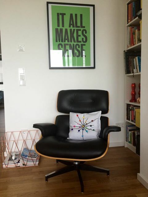 tuliManna pillow hugged by an iconic Eames lounge chair in a hip Berlin apartment - it all makes sense