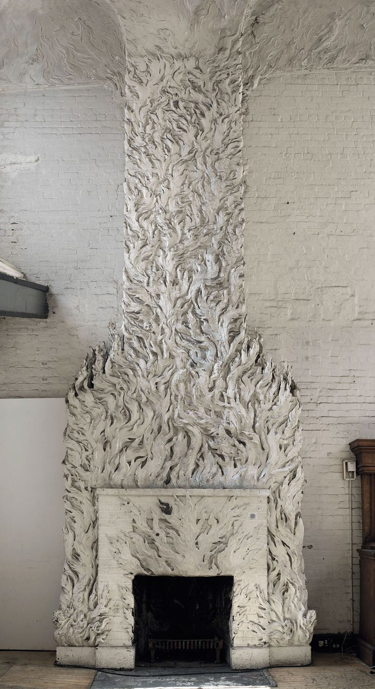 incredible fireplace Chanler created for Gertrude Vanderbilt Whitney; he began designing it in 1918. The unique surround of bronze and plaster relief flames was originally painted in red and orange colors so it would really have looked as if it were on fire.