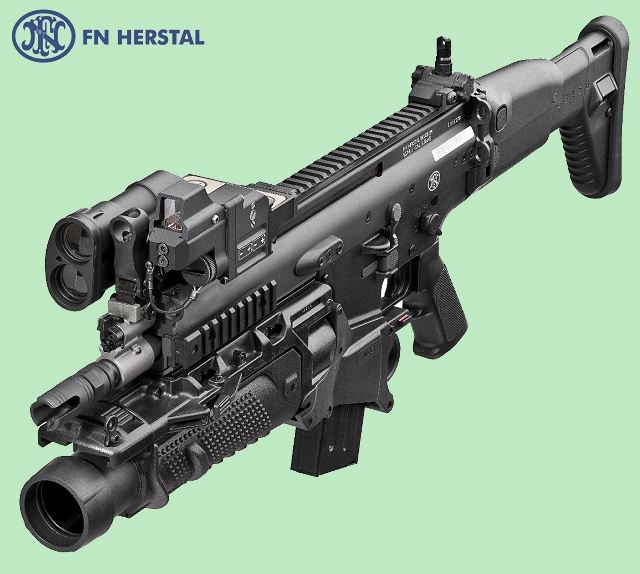 FN_Herstal_fire_control_unit_FCU-850N_mounted_on_FN_ SCAR_rifle_Belgium_Belgian_Defence_Industry_001.jpg (640×574)