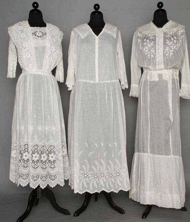 THREE WHITE DAY DRESSES, 1914-1918 : All fine cotton lawn: 2 loose fitting w/ drop waists, embroidered midi collars, hem flounces, & cuffs; 1 square neckline, chemical lace shoulder bands, lace & embroidered hem.