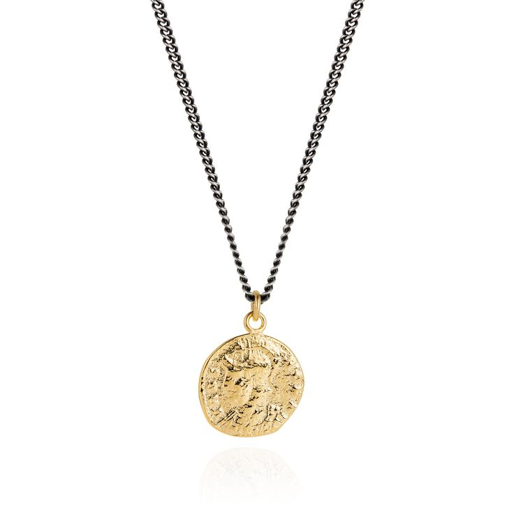 Joy Everley  Golden Roman Coin Necklace : This glowing golden coin looks as thought it has been dug out of a treasure chest!  The design is based on a cast made from an original Roman coin, depicting the goddess Roma on one side, Romulus and Remus on the other. It has been cast in silver and plated in bright 24ct yellow gold. The Vermeil Roman Coin is suspended from an oxidised Sterling Silver chain to create a dramatic contrasting look.  This piece is handcrafted using traditional lost wax…