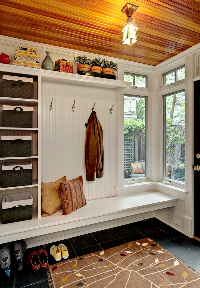 awesome ... a little basket for each child, a bench, coat hook.  seems practical and classy