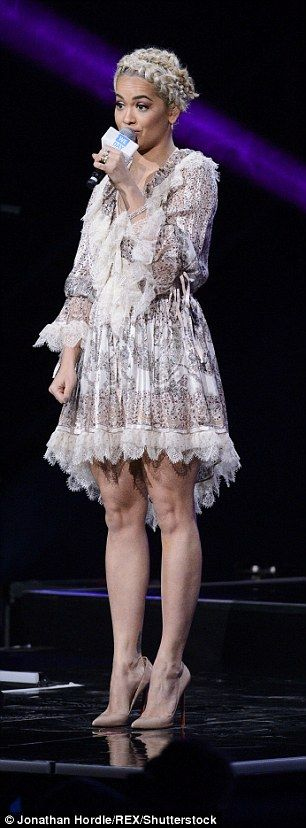 Check out the dress:The musician wore a pretty paisely print dress for the event at Wembl...