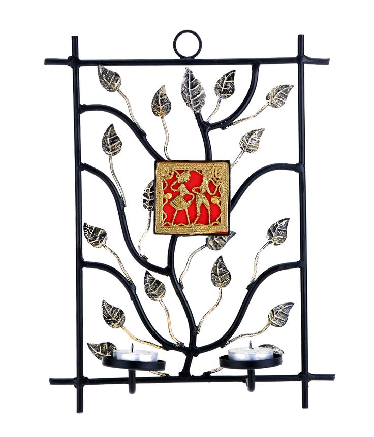 This rectangular wrought iron candle stand is beautifully crafted with a feel of tree branches. The dhokra plate in the middle enhances its beauty. It hold's two tea light candles which when lighted would enhance the beauty of your wall.