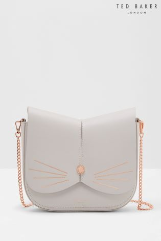Adorable Fashion Shoulder Bag In White With Small Golden Cat Face For A Minimalist Wardrobe By Ted Baker Handbags.