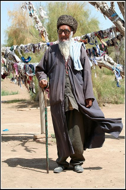 Dignified gentleman at a prayer flag tree in Turkmenistan. (V)