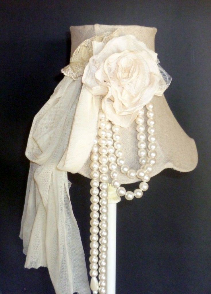 This would be so easy to reproduce with your current plain lamp just using a childs headband and material and pearls....better than spending $177 from ebay.