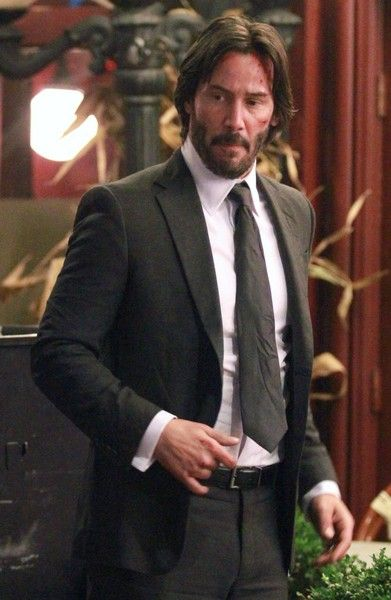 Actor Keanu Reeves shown with bloods and cuts on his face while filming 'John Wick 2' in New York City, New York on October 30, 2015.