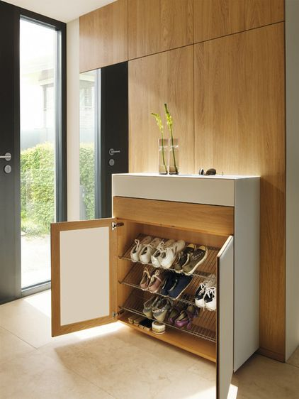 slim shoe storage unit (which you can pick up at lots of big retailers these days). Then tailor the unit to your space by having a cabinet built around it, with doors