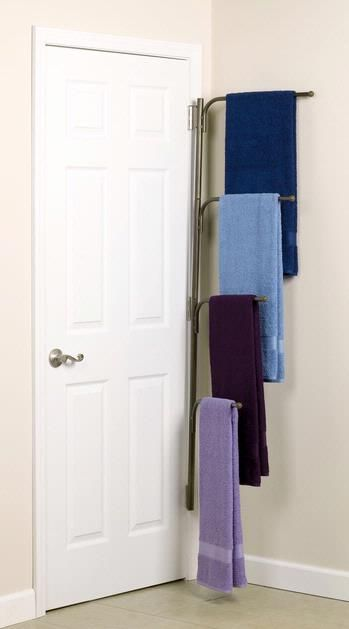 Behind door towel bar