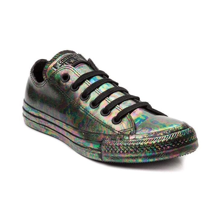 Tune up your look with the new Chuck Taylor All Star Lo Oil Slick Sneaker from Converse! Combine your unique personality with the awesome style of the Oil Slick Chucks, sporting a low-top design, constructed with durable rubber uppers with a marbled, oil slick print. <b>Available only online at Journeys.com and SHIbyJourneys.com!</b>  <br><br><u>Features include</u>:<br> > Low top style constructed with a durable rubber upper and soft textile lining<br> > Lace-up closure<br> > Signature…