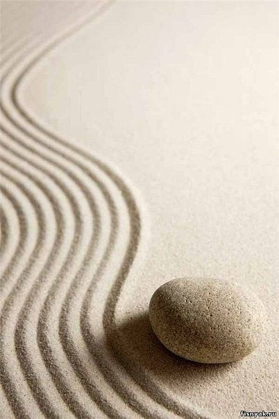 metal in the form of the rock, water with the waves. Very Zen like! a great photograph to hang in career area or travel/helpful people area.