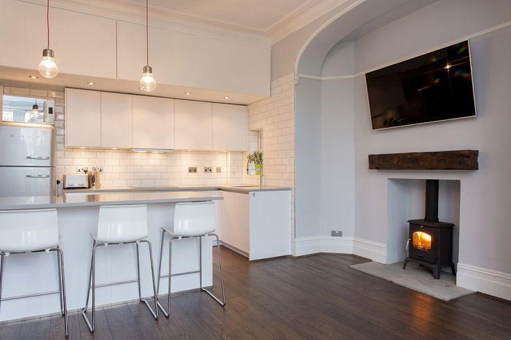 White Handleless Beauformat KItchen in ground floor flat with exposed brickwork