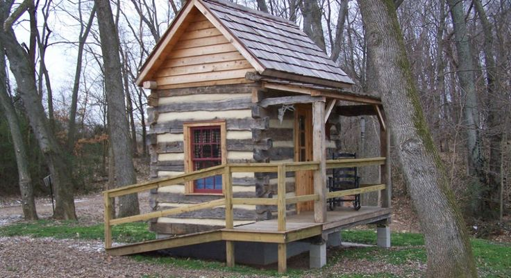 Inside a small log cabins small log cabin 920x500 log for Small cabin construction