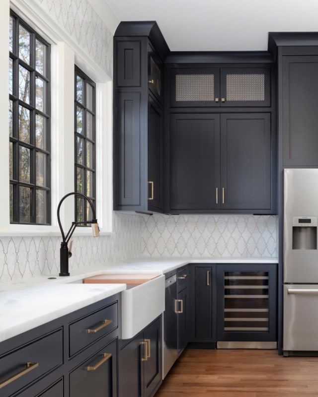 What A Magnificent Kitchen The Mixture Of Warm Grey Cabinets And White Open Space Creates The P White Kitchen Design Kitchen Design Dark Blue Kitchen Cabinets