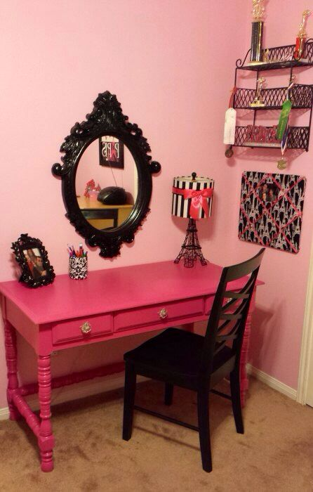 Zoe's Paris room  My mom refinished this desk that she found on the side of the road pink & added glass nobs. The mirror & lamp are from hobby lobby. The chair was given to us by a friend. The French bulletin board was a zebra bulletin board from her old room that I just covered with new fabric & re-did the ribbon on. The pencil holder is actually a progresso soup can that I made with batting and extra fabric. She absolutely adores her hot pink desk / Paris vanity area!