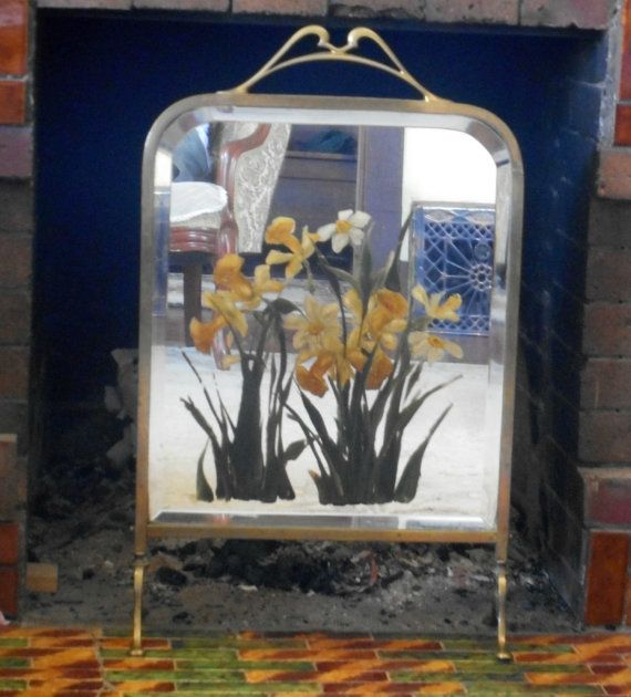 A great Victorian fireplace screen but why not use it to conceal unwanted wires and clutter. A lovely work of art....$295https://www.etsy.com/listing/236532489/victorian-fireplace-screen-hand-painted?ref=shop_home_active_1