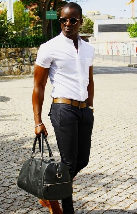 Mans Guilt Sleek, white shirt, jeans, casual brown shoes, bag