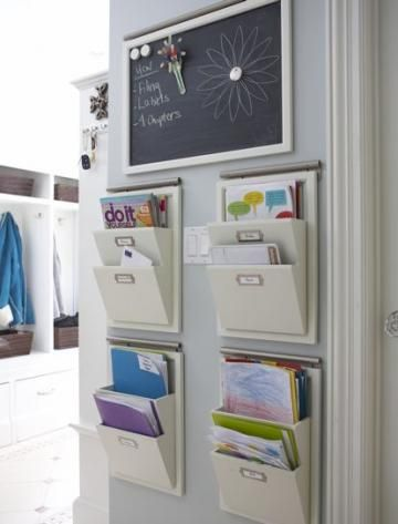 File it away Keep papers off the counters and table with hanging file holders between the kitchen and mudroom. Label one for each member of the family, plus one for incoming and outgoing mail. Add a magnetic chalkboard for daily notes and reminders. No more running around looking for homework as the bus pulls up!