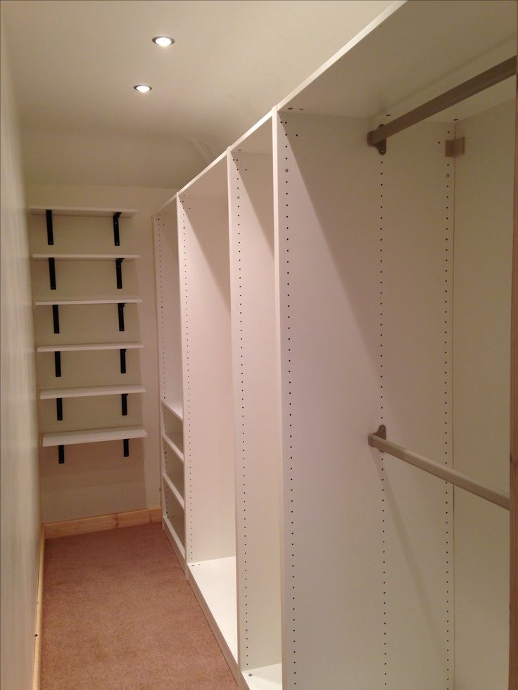 Small walk-in-wardrobe using Ikea PAX wardrobes & shelving.