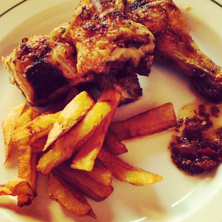 The authentic peri peri chicken with sweet potato chips and side serving of whisky-infused peri peri sauce: served in Foz do Banho, Monchique