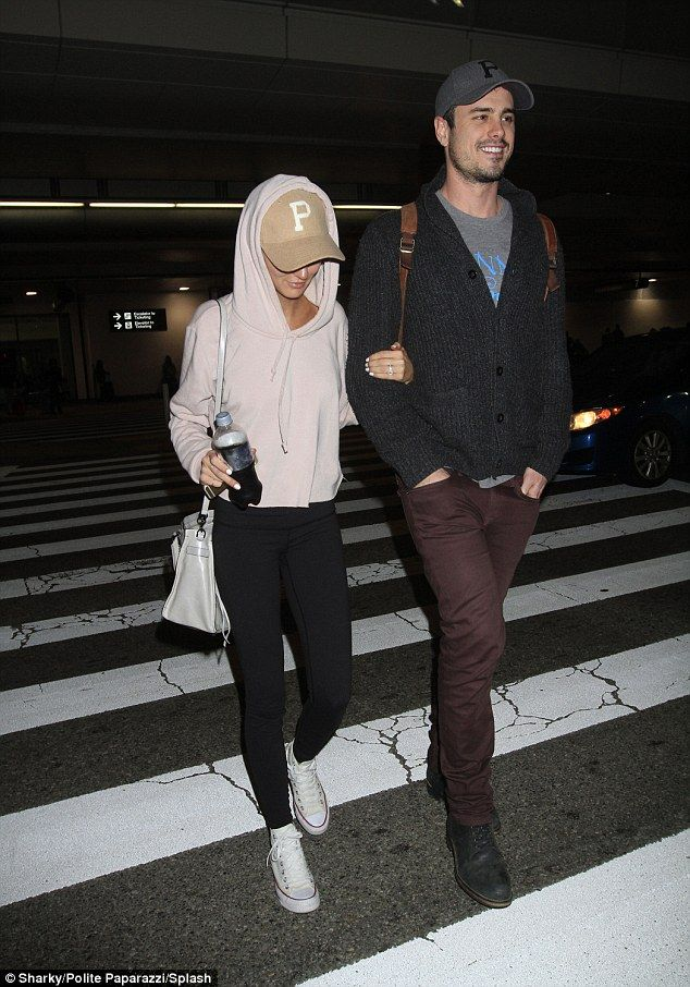 Love is in the air! Former Bachelor Ben Higgins and his fiancée Lauren Bushnell looked every inch the happy couple as they jetted into Los Angeles on Thursday, arm-in-arm