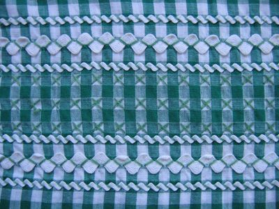 rickrack, cross-stitch, and/or chicken scratch on gingham