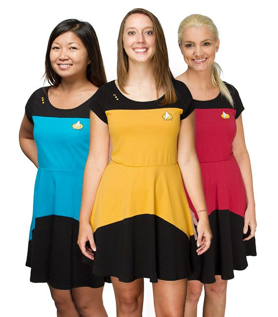 Engage cuteness. Warp factor 9. This Star Trek TNG A-line Dress is the perfect Trek-wear for women of the Enterprise.  This dress comes in three colors, one for each department, with a printed comm badge and pips. Now you can represen
