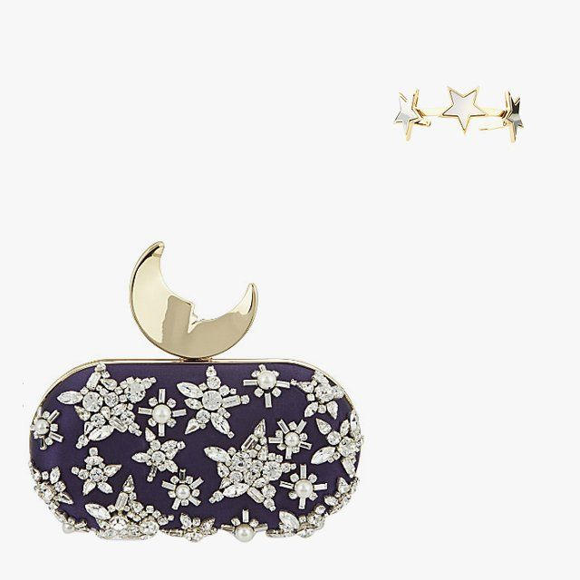 Benedetta Bruzziches Moon and Stars crystal-embellished clutch, $735, for information: selfridges.com; Givenchy Stars cuff bracelet, $660, bergdorfgoodman.com