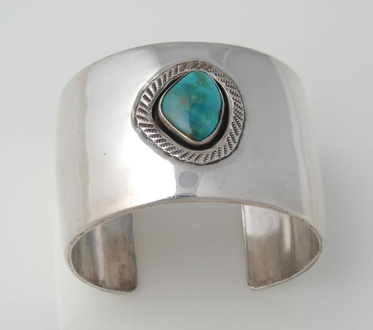 Navajo Shadow Box Bracelet: Cuff bracelet with a narrow shadow box setting that houses a large Blue Gem Mine (Nevada) turquoise stone in the center. Photo by Jannelle Weakly, from the permanent collections of Arizona State Museum.