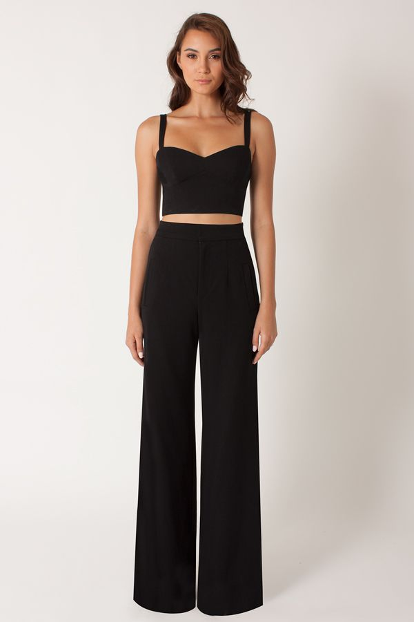 "Black Halo - Kalem 2-Piece Jumpsuit - Black | The playful Kalem 2-piece jumpsuit is cut from our double face viscose blend. Bra top features a techno knit back while the high-waist pant has slash pockets at hip. Top measures 15.5"" from shoulder. Pant measures 35"" from inseam."