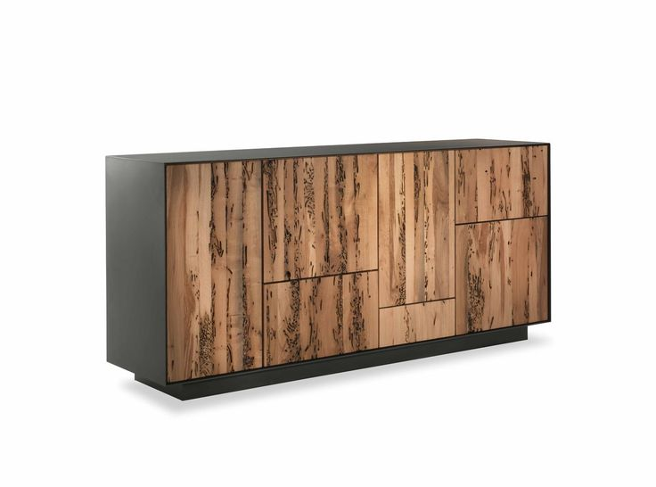 Dresser made from hardwood and plywood, enclosed by an iron or wood frame. Asymmetrical lines for the doors and drawers, assembled with dovetail joints and the push-pull opening system.Finish: base of oil / natural wax of vegetable origin with pine extracts.
