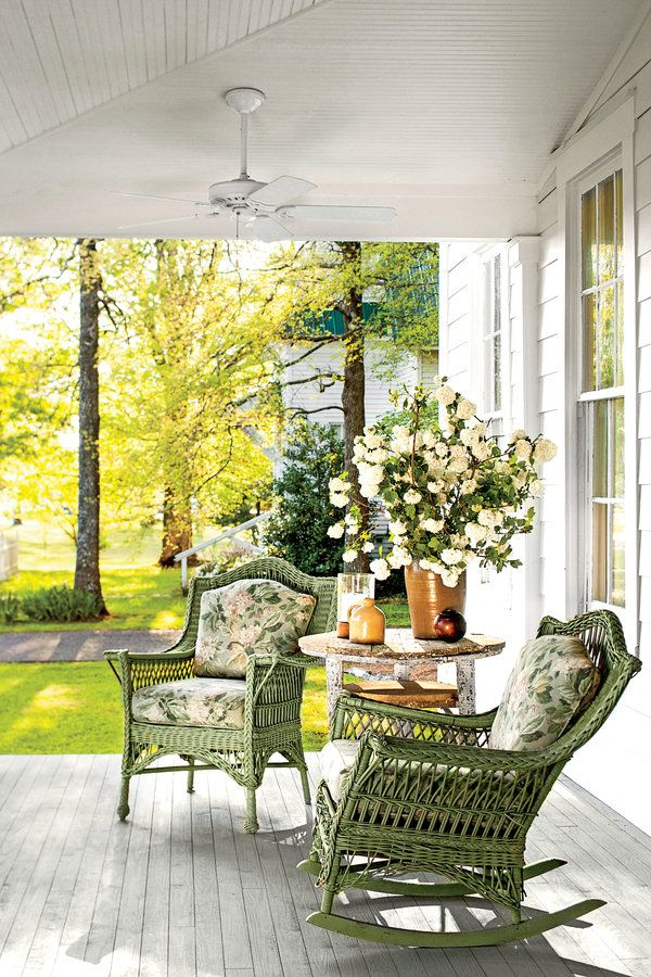 "Old green wicker porch furniture ""just kind of goes,"" says the home's designer Rachel Halverson. The house and the church next door were both built around 1890."