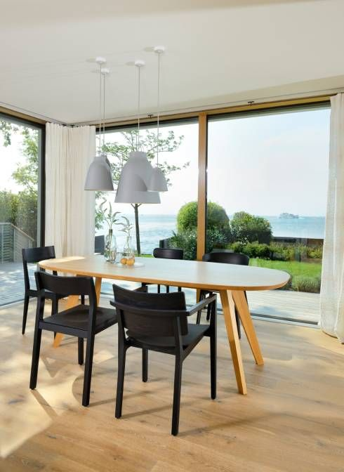 Dining room with a beautiful view in Germany by Bau-Fritz GmbH & Co. KG. See the rest of this family home in the article. #dining rooms #views #homify