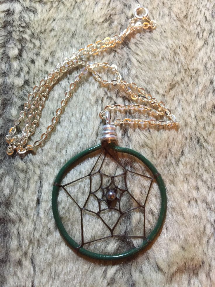 Hand wrapped, woven and painted hunter forest dark green dreamcatcher pendant with pewter glass pearl and 18' nickel free chain by EarthDiverCreations on Etsy https://www.etsy.com/ca/listing/496805635/hand-wrapped-woven-and-painted-hunter
