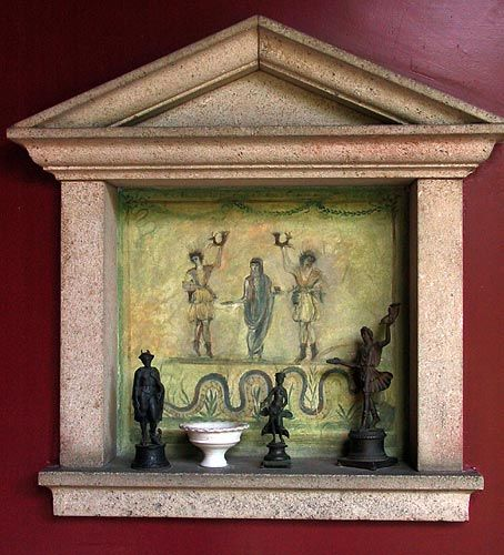 A modern replica of a lararium in the reconstructed roman villa at Augusta Raurica, Switzerland. The painted background is based on lararia from Pompeii.
