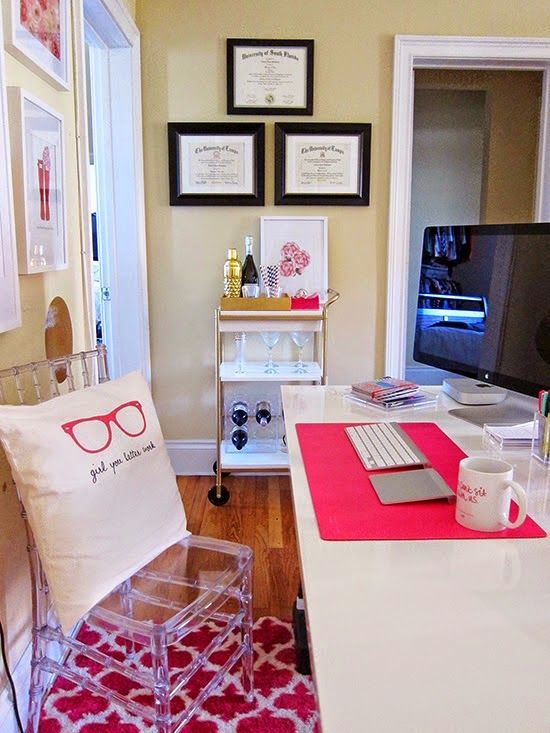 HOME OFFICE: Framed Diplomas, Clear Acrylic Chair, Bright Patterned Area Rug, Apple Desktop Computer, Bar Cart