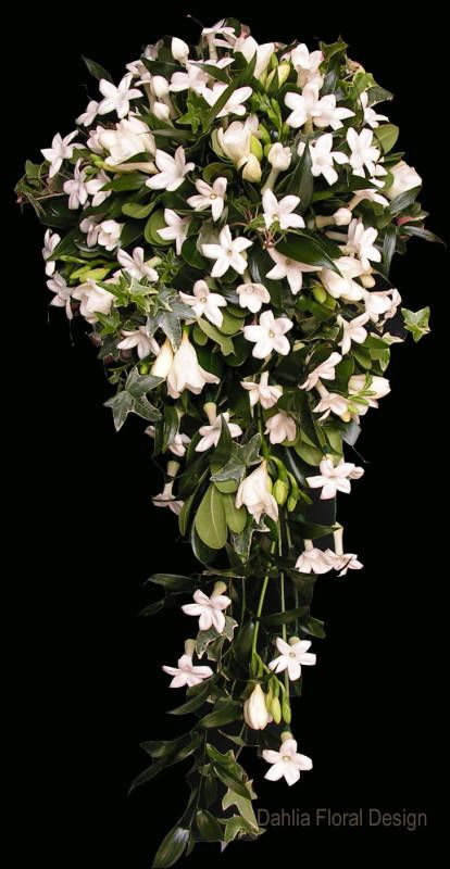 white cascade stephanotis star shaped wedding flower bridal party bouquet