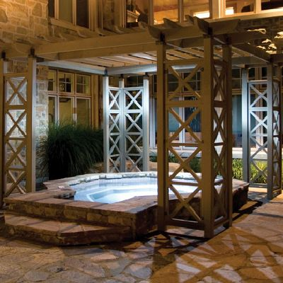 WOOD PERGOLA KIT: Unique Pergola over a raised stone hot tub on a stone patio.