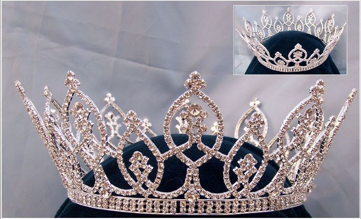 Beauty Pageant Rhinestone Full Crown Tiara Magnificent rhinestone FULL CROWN made with the finest rhinestones and silver plated metal. DIMENSIONS: 4 inches tall 6.5 or 7 inches inches wide FULL CROWN                                                                                                                                                      More