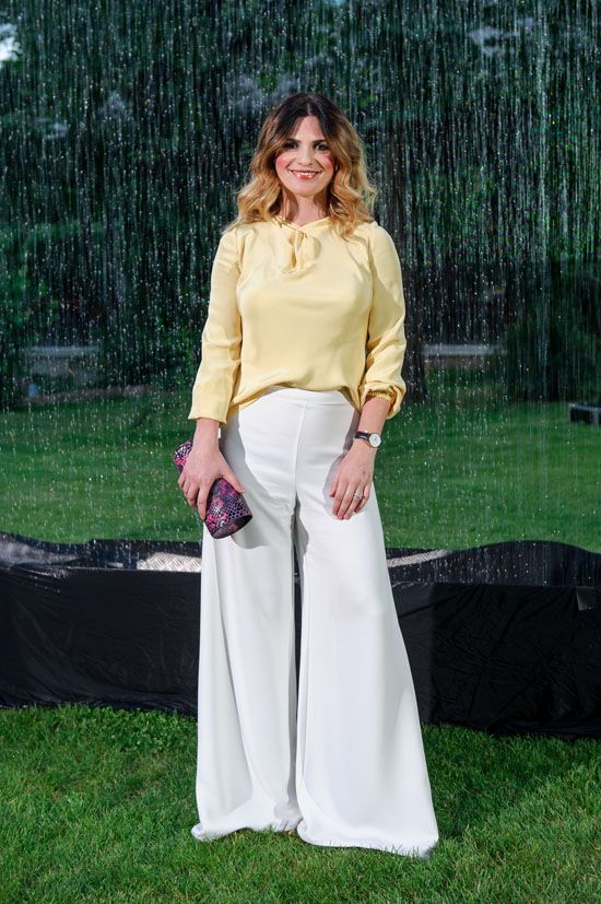 Ellie White wearing http://shop.laurahincu.ro/product/office/white-revolver-silk-crepe-flared-pants/