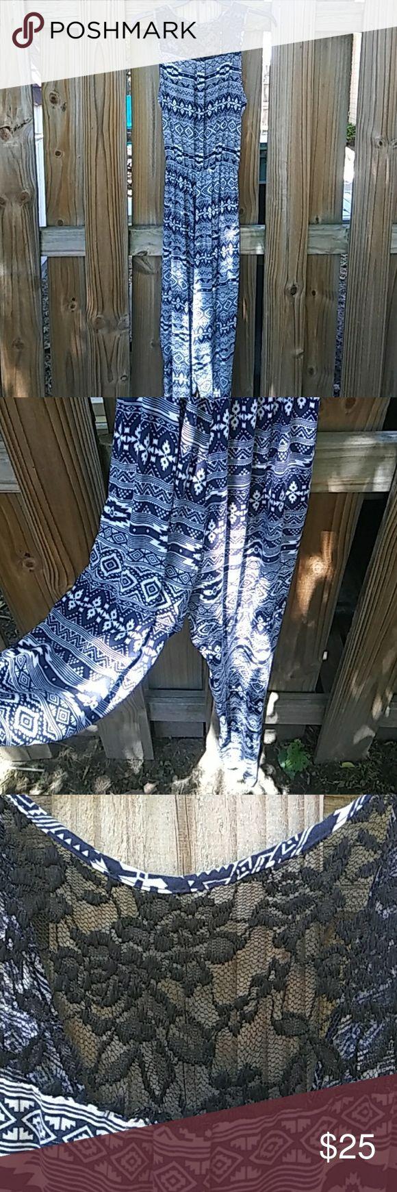 Aztec print jumpsuit Navy blue and white Aztec print pants jumpsuit. Zipper back laxe detail neck Dresses
