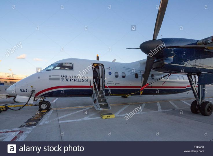 If you decided to build your own DeHavilland Dash-8 rubber-powered model, here is a U.S. Airways Express paint scheme to whet your appetite. The black line plugged into the nose is an APU (Auxiliary Power Unit) connection to run electrical needs when the airplane is on the tarmac.