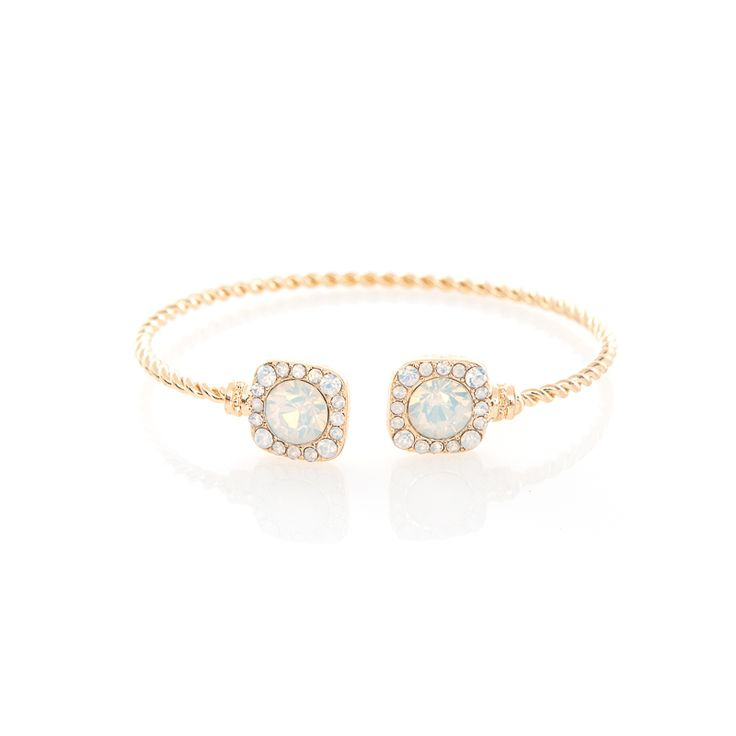 Designed to layer on a bare wrist, the Cristina cuff sparkles with opal colored crystals set on a gold plated base. Embellished in a clustered manner, this bracelet is an evening must-have.