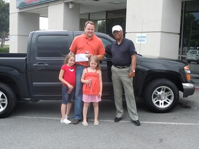 Folger Subaru Sales Consultant Bill Barber with Mr. Barrett and his daughters and their 2006 Chevy Colorado!