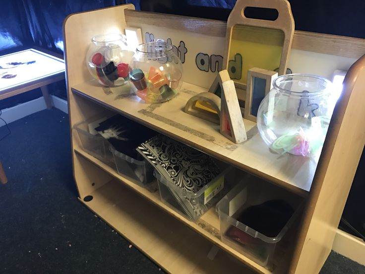 Light and dark table resources and cupboard  Preschool