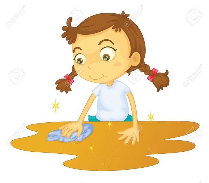 La niña limpia una mancha en la mesa con un paño.