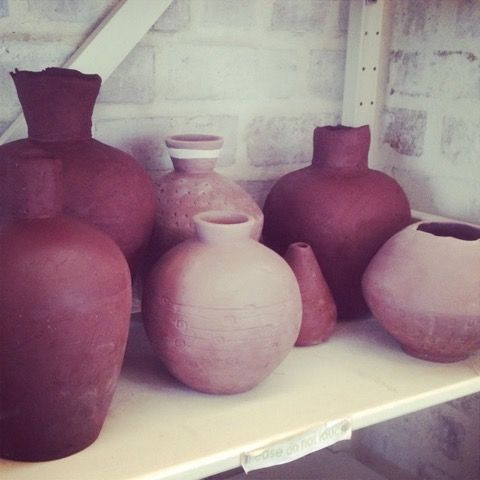 Sculpting pots is a favourite.  Here they are drying for a bisque firing.