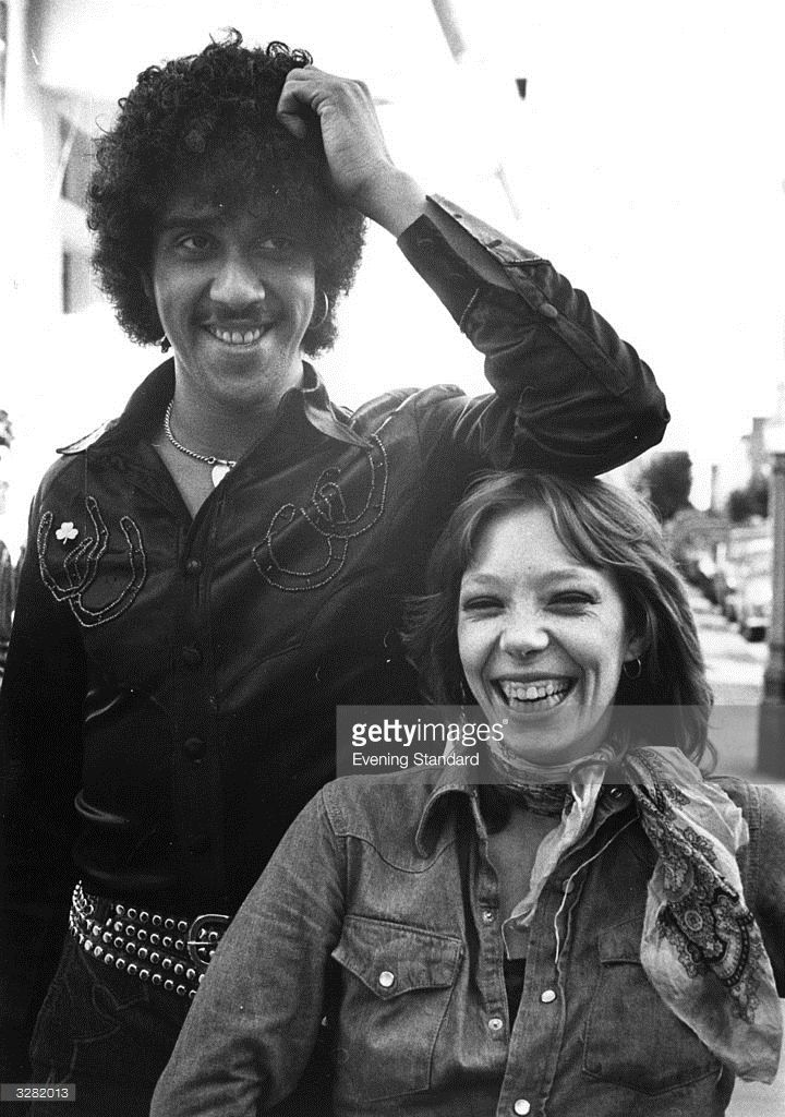 Singer and bass player Phil Lynott (1951 - 1986) of Irish rock group Thin Lizzy, with Brandy Young, twenty four year old roadie for the group.